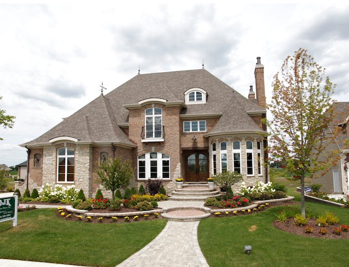 Front exterior view of a house built using the Wyndermere custom floorplan, Stewart Ridge, Plainfield, IL