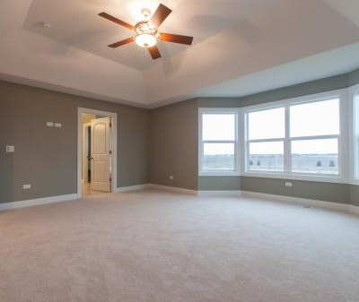 The master bedroom in a house built with the Brayden floor plan