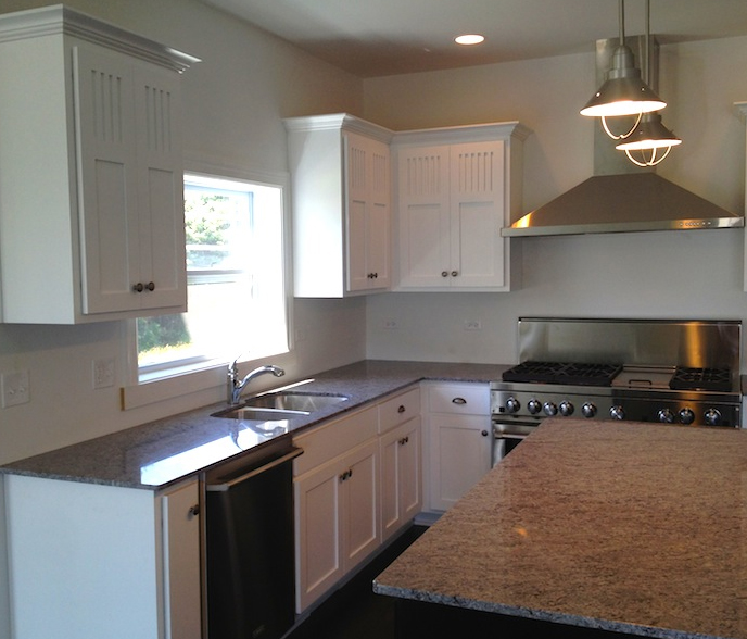 View of the kitchen in the Bella floor plan from DJK Custom Homes