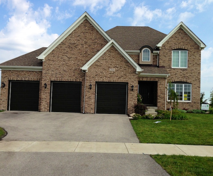 Exterior view of a custom home built using the Jasmine Floorplan in Plainfield, IL